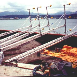 Loading HIAL poles on barge for transport out into Subic Bay